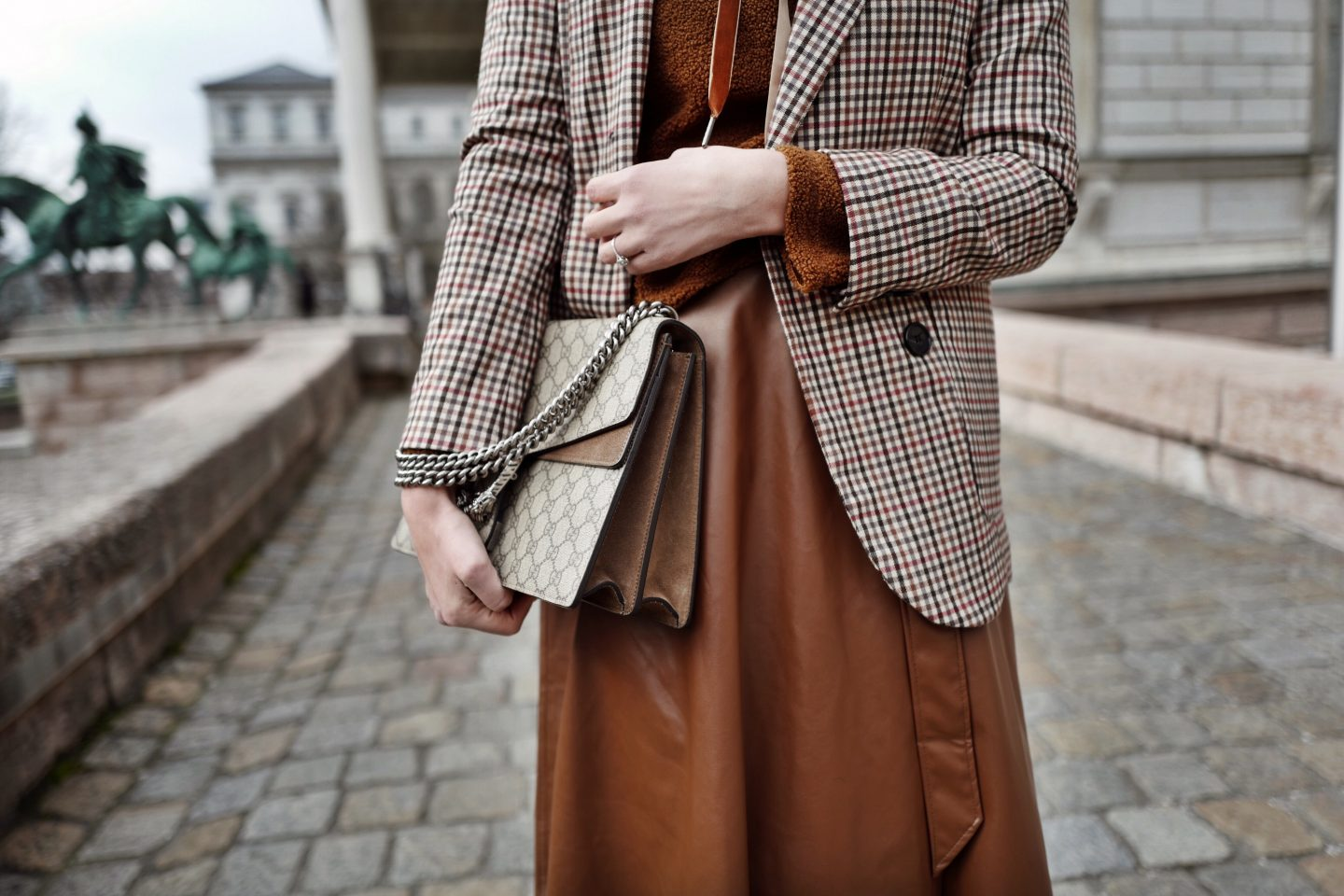 Midi leather skirt, checked blazer and teddy sweater